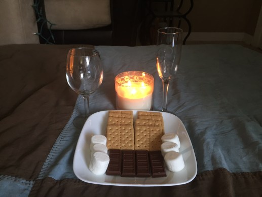 Board games, sushi, and smores were a perfect touch for this at home date idea. See what else we did on this mini getaway in our own home date night idea