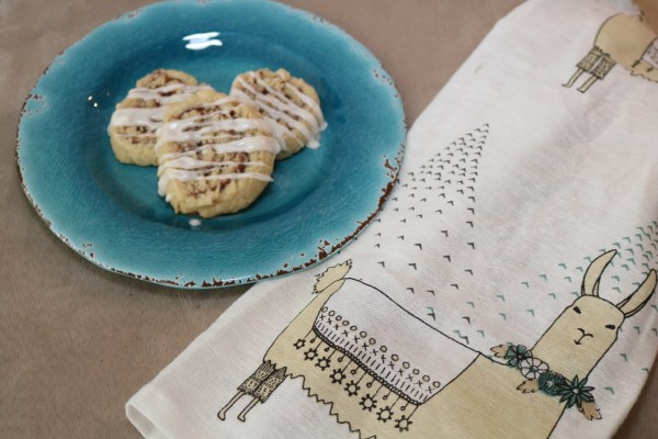 Cinnamon Roll Cookies - These cookies are your favorite breakfast in a dessert. Soft buttery sugar cookie with cinnamon sugar filling drizzled with icing. So delicious, you can't just have one! Adventures of B2