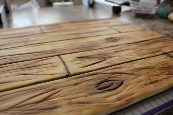 step by step how to make a faux wood fondant cake board.