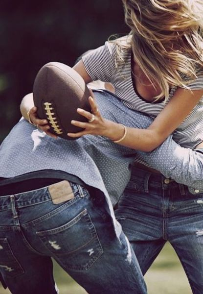 couple playing a friendly game of tackle football. A great way to stay active and have some fun.
