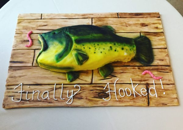 a groom's cake carved into the shape of a fish. This simple carving for beginners. Learn step by step how to make this amazing cake.
