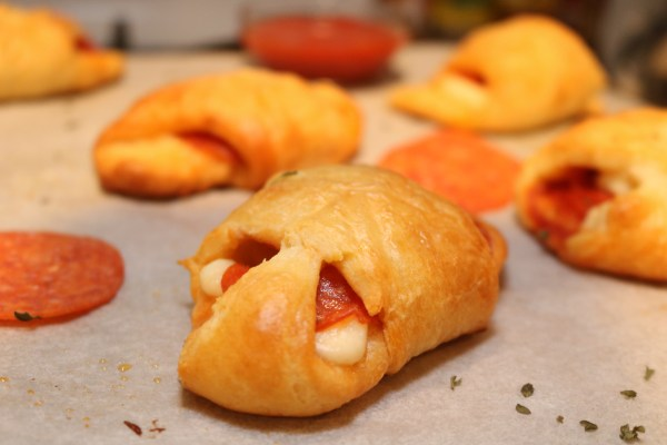 Pizza pocket stuffed with cheese and pepperoni. Make these simple mini pizzas in 30 mins or less!