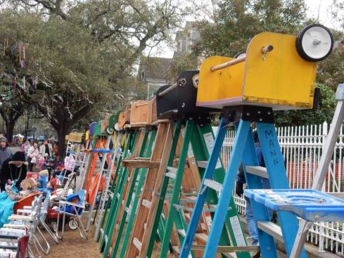 Mardi Gras ladders line the streets before the parades in New Orleans. Learn how to make your trip successful with the ultimate guide for surviving mardi gras from a local's perspective.