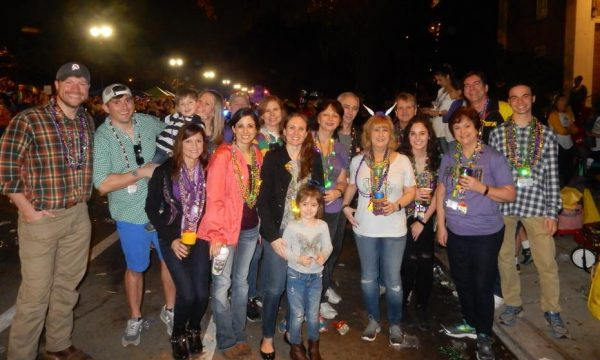 A whole group of people enjoy Mardi Gras in New Orleans. Get your FREE guide on how to survive Mardi Gras and make it successful over at Adventureosfb2.com