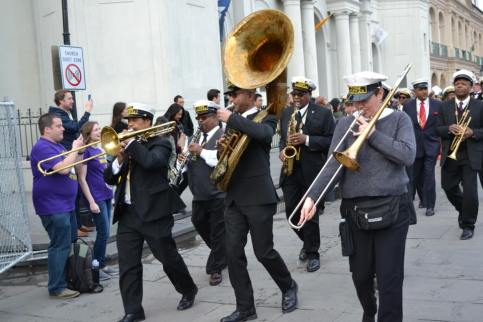A random band walks down the streets of New Orleans playing music during mardi Gras. Just one of the many wonderful things about New Orleans. Learn all about Mardi Gras and how to make the most of your experience with this free guide to Mardi Gras.