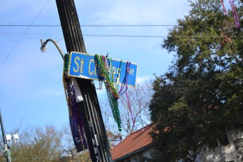 st charles sign weighed down by beads during Carnival season in New Orleans. Learn the best tips for surviving your first mardi gras with my free guide.