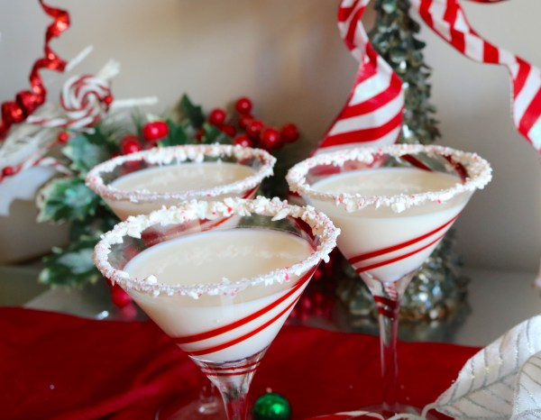 A delicious holiday martini bursting with peppermint and swirls of cream making this peppermint martini so satisfying! Perfect Christmas party drink! - Adventures of B2