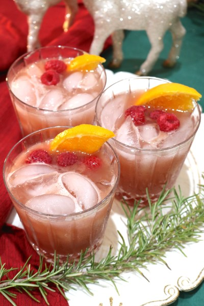 Winter bourbon punch is a delightful seasonal cocktail. The whiskey pairs beautifully with the bold flavors of orange and raspberry! A winter delight for any holiday celebration!
