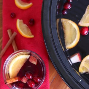 You can't go wrong with a holiday spiced mulled wine recipe especially in the crock pot! This cocktail is warm, flavorful and filled with fruit and spices. A tasty treat for all your holiday guests!
