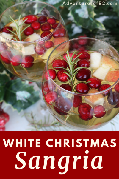 Spread Christmas cheer with this White Christmas Sangria. A sweet wine with brandy and apple cider and packed with fresh fruit for a delightful holiday drink! #holidaydrinks #holidaycocktail #christmasdrink