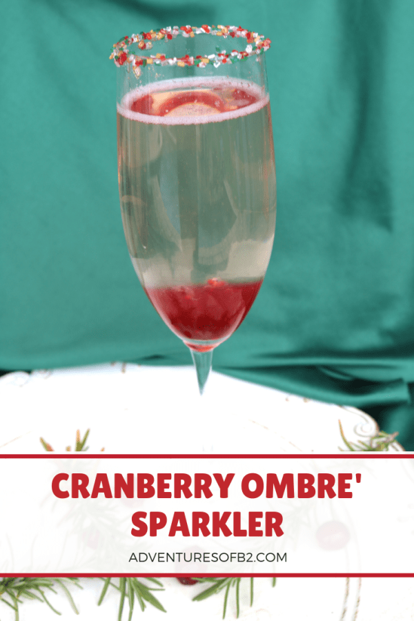 cranberry ombre sparkler is a delightful champagne cocktail that is filled with cranberries and champagne. Serve them up to your party guests to ring in the New Year! #champagnesparkler #holidaycocktail #drinkrecipe