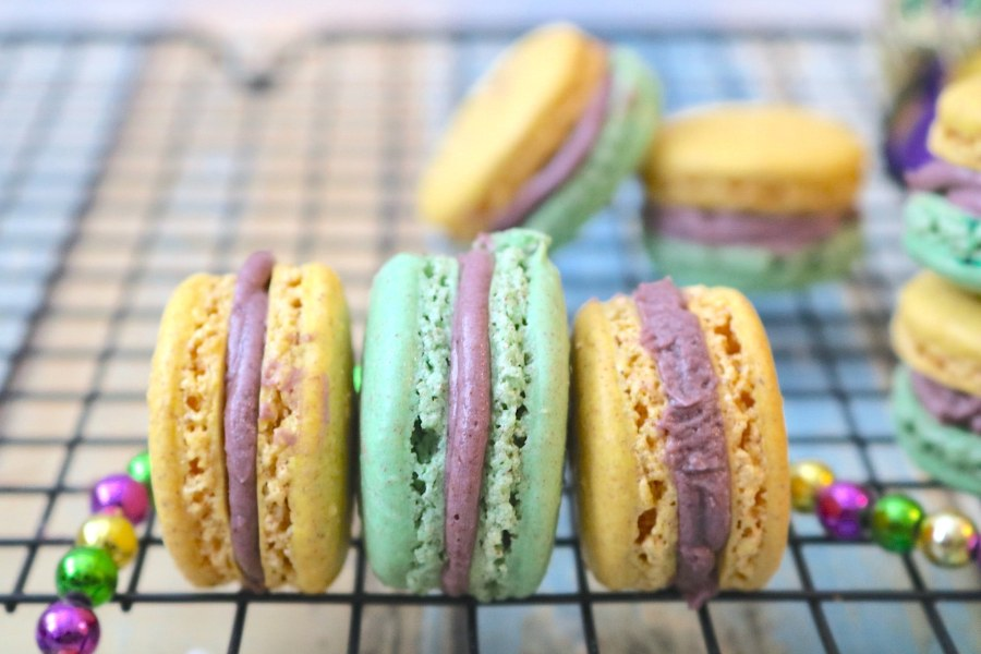 It's carnival time in New Orleans and what better way to celebrate than with Mardi Gras King Cake Macarons! The light fluffy macarons have flavors of cinnamon swirled with vanilla just like king cake. In festive purple, green, and gold colors, these will be the perfect little treat at your next Mardi Gras party! - Adventures of B2