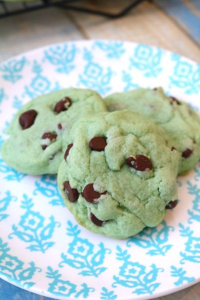 mint chocolate chip cookies are your classic favorite ice cream in a warm fluffy cookie. Peppermint dough swirled with chocolate chips in a festive green color. Perfect for Christmas holiday celebrations! - Adventuresofb2.com