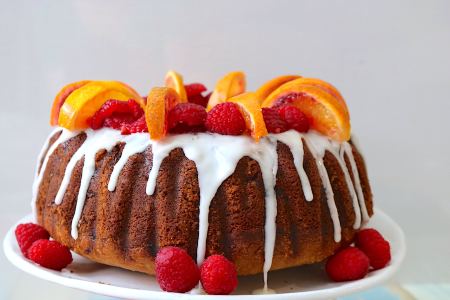 raspberry & blood orange bundt cake is a moist bundt cake recipe filled with sweet blood oranges and raspberry topped with a blood orange glaze. A simple yet elegant bundt cake that is so easy to make for any occasion! - Advemturesofb2.com