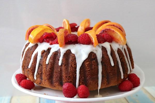 raspberry & blood orange bundt cake is a moist bundt cake recipe filled with sweet blood oranges and raspberry topped with a blood orange glaze. A simple yet elegant bundt cake that is so easy to make for any occasion! - Advemturesofb2.com