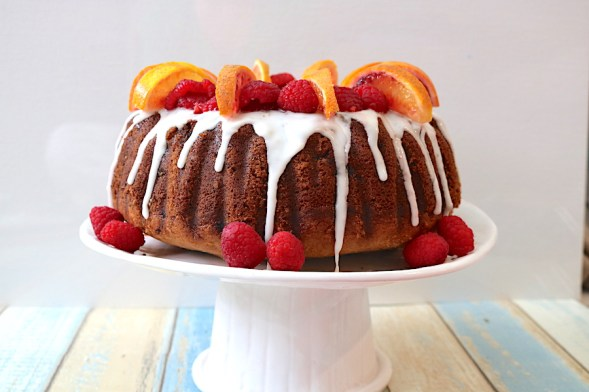 Raspberry and Blood Orange Bundt cake is simple cake recipe for beginners. Packed with flavors of sweet blood oranges and raspberries topped with a delicious blood orange glaze. A simple bundt cake but oh so picture worthy! - Adventuresofb2.com