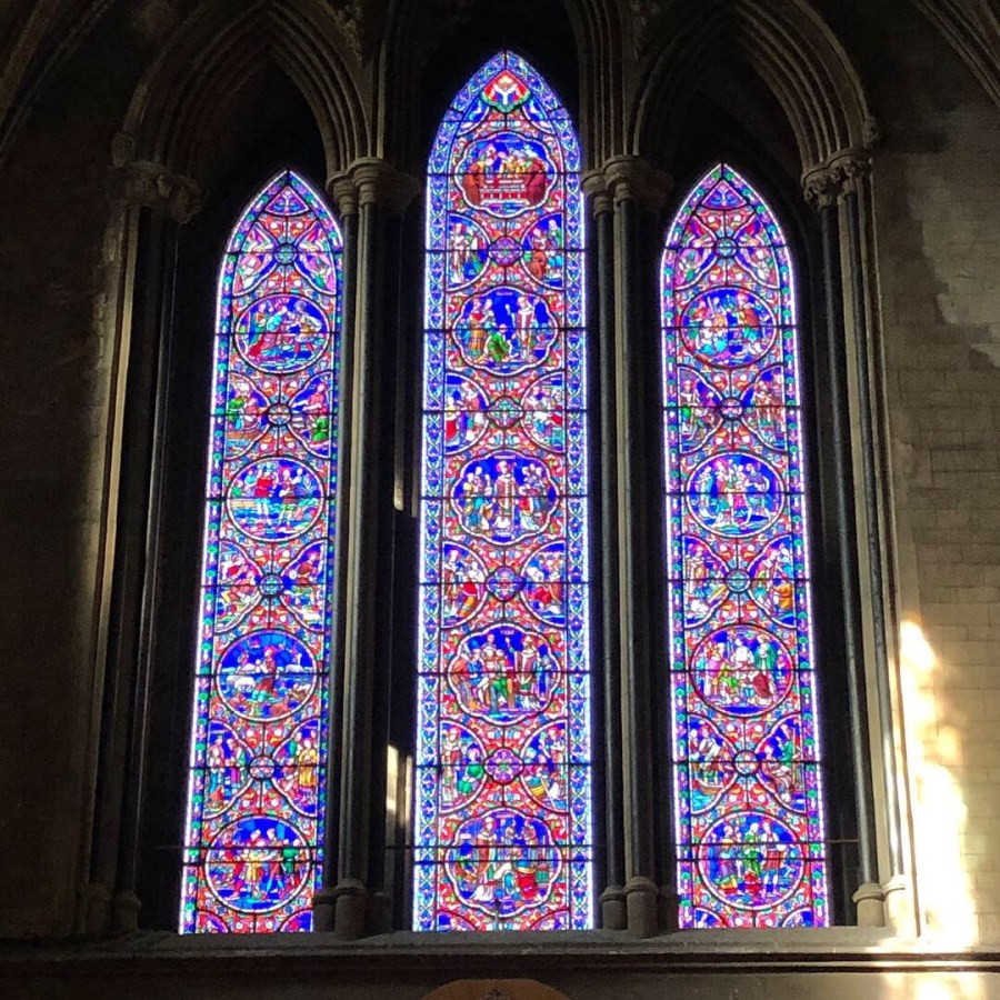 The beautiful pictures on the stained glass window at the St. Patrick's Cathedral in Dublin, Ireland. A must see stop on your Ireland road trip itinerary. - adventuresofb2.com
