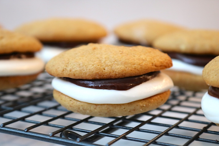 Who doesn't love a great s'mores recipe! Especially one that doesn't require a campfire. A twist on the classic camping dessert. This cookie recipe will be a family favorite for sure! With a soft graham cracker cookie with a sweet chocolate ganache and a fluffy marshmallow buttercream. Slightly less messy but worth every bite! - Adventuresofb2.com