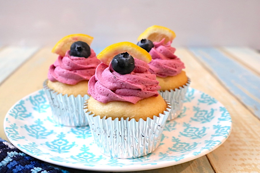 One of my favorite springtime desserts is a lemon blueberry cupcake. Packed full of flavors in the moist lemon cupcake and the brightly swirled blueberry buttercream. A fabulous cupcake for any occassion. - Adventuresofb2.com