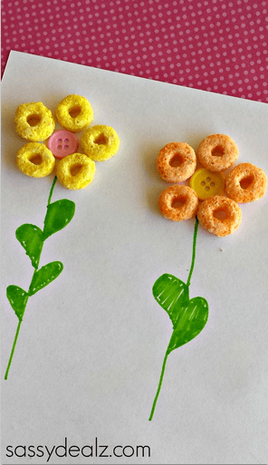 Let children express their creative side by using froot loops cereal to create pictures like this one with flowers. See other crafts over at adventuresofb2.com