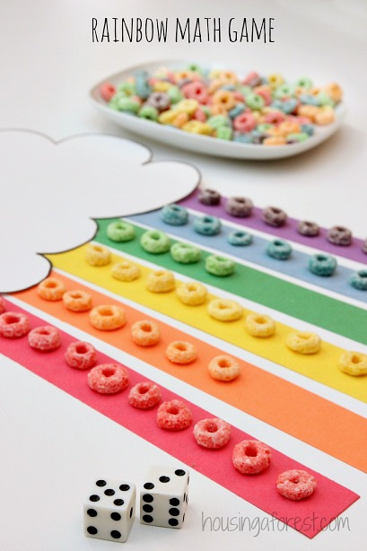Rainbow math game using froot loops from housing with a forest! This a great educational game with cereal that help children learn colors, counting, and addition. See more great crafts and activities with fruit loops here! - Adventures of B2