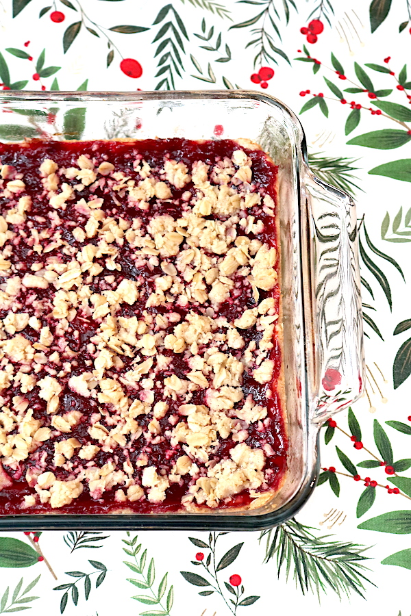 Nothing beats fresh cranberries during the holiday season. Cranberry Crumble Bars are a delicious cookie bar that can double as a snack or dessert. Its soft cookie base topped with a not overly sweet cranberry filling topped with a crumble topping with oatmeal and dashes of cinnamon. The combination makes this such a warm, cozy, comforting dessert. - Adventuresofb2.com