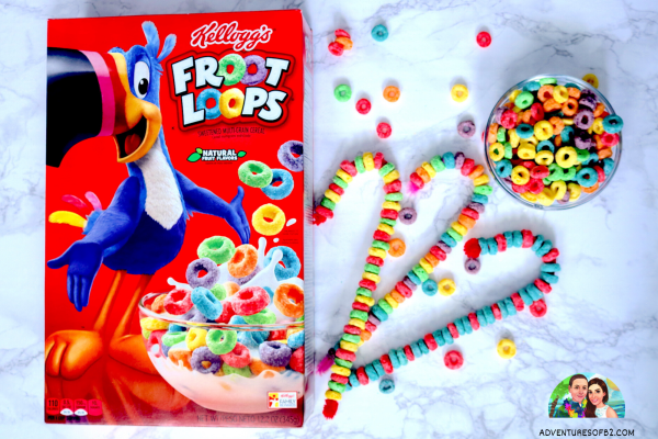 Froot Loop candy canes are a simple, fun way to decorate this Christmas! Using pipe cleaners and froot loops, let your child go wild with a variety of different color combinations. A festive way to bring holiday cheer! See more crafts with froot loops at adventuresofb2.com