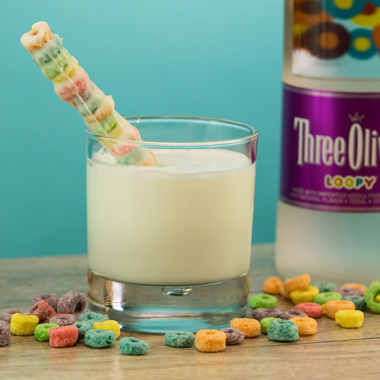 Fruit Loops cereal straw is a fantastic DIY to add to your cereal bowl to drink your milk, or to your fancy adult froot loop cocktail! Super simple and very easy to make this fully edible straw! - adventuresofb2.com