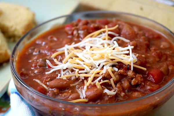 All about comfort food with this chili recipe. It's chunky and hearty as it's filled with beans, meat and vegetables. It's the right amount of hearty and spice with unbelievable flavor. It'll have everyone wanting seconds! Serve with many different toppings , serve with a side of tortilla chips or cornbread! - adventuresofb2.com