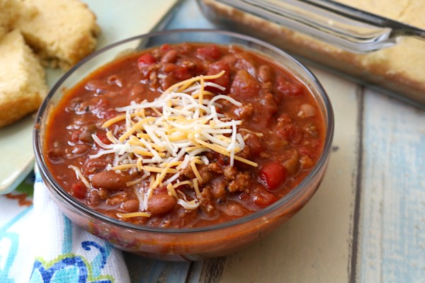Homemade chili is the ultimate comfort food for cold winter nights. Thick and hearty with a side of spice! Filled with beans, meat, and vegetables for a wholesome meal your whole family will love! Serve with a variety of toppings or scoop it up with chips. - adventures of b2