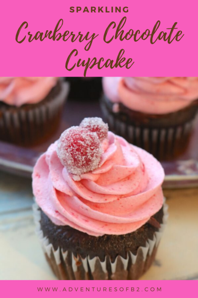 Sparkling Cranberry Chocolate Cupcakes are as delicious as they are moist. With a rich chocolate cupcake filled with cranberry chocolate ganache topped with a sweet cranberry buttercream and sugar cranberries. A perfect party dessert for any occasion! #valentines #dessert #cupcakes #cranberry - Adventuresofb2.com
