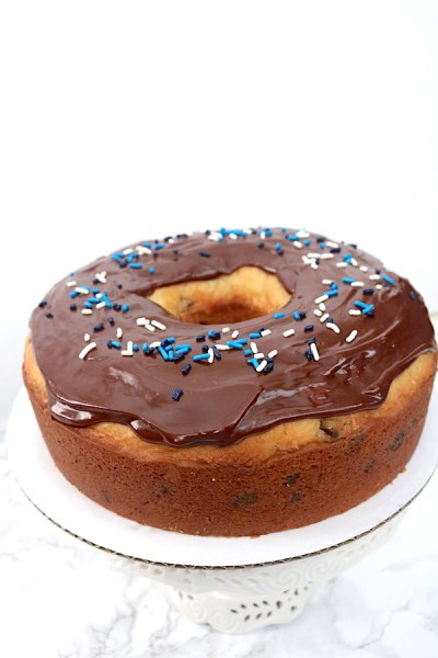 A simple pound cake shaped into a donut! An easy step by step process for making a donut cake that you can take to any party! - adventuresofb2.com