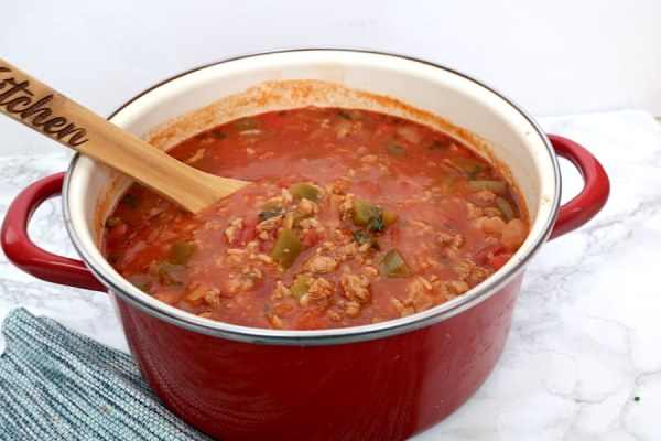 Stuffed pepper soup is filled with rice and beef in a tomato based broth and seasoning. It's an inexpensive thick and hearty soup that will fill your whole family up! - adventuresofb2