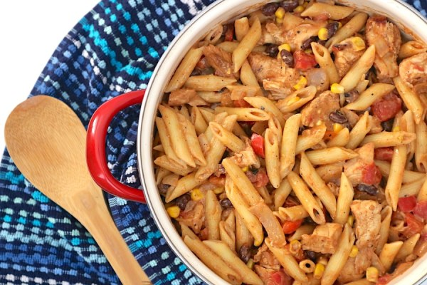 Southwest Chicken Pasta is a one pot dinner that is so easy and delicious, it'll definitely be a crowd pleaser. Packed with corn, black beans, tomatoes and chicken all mixed other is a simple 2 ingredient southwest sauce. - adventuresofb2.com