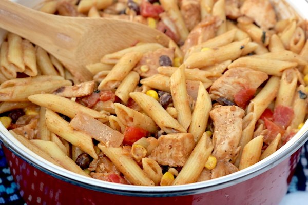 A quick hearty pasta for busy weeknights! Southwest Chicken Pasta is filled with corn, black beans, peppers and onion in a flavorful southwest sauce! - adventuresofb2.com