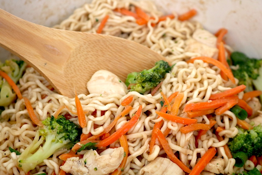 A simple stir fry made with chicken, broccoli, carrots, and ramen noodles in a savory sauce. Kid friendly and easy to make! This Ramen stir fry with chicken will sure to be a hit! - adventuresofb2.com