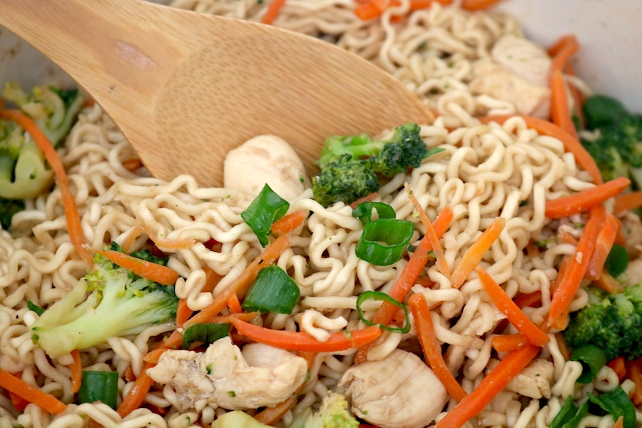 Quick and easy Chicken Ramen Stir Fry is a family favorite that is your new go to weeknight dinner. Packed full of veggies, juicy chicken all in a savory sauce over ramen noodles. A quick dinner for the whole family in less than 30 minutes- adventuresofb2.com #30minutemeals #weekdaymeal #weeknightdinner #quickandeasy