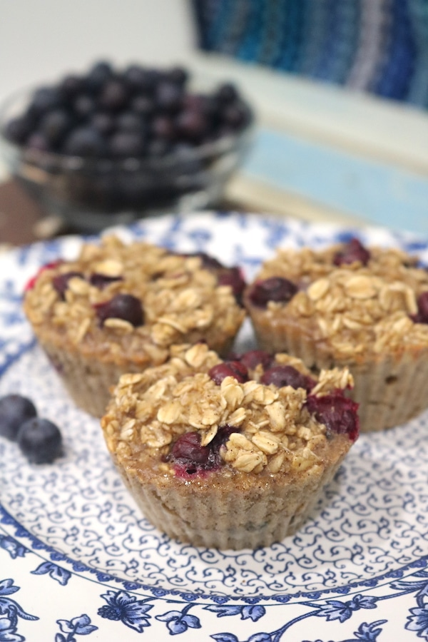 Baked blueberry oatmeal cups are an easy meal-prep breakfast for the busy mornings on the go. Packed with oats, and blueberries for a filling, nutritious breakfast! - adventuresofb2