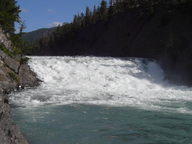 Bow River Falls is located within walking distance downstream of Banff.