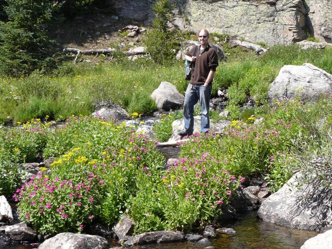 Lanis looking for the rest of the Beartooth High Lakes trail. Not really finding it. Lots of flowers blooming by the stream, though!