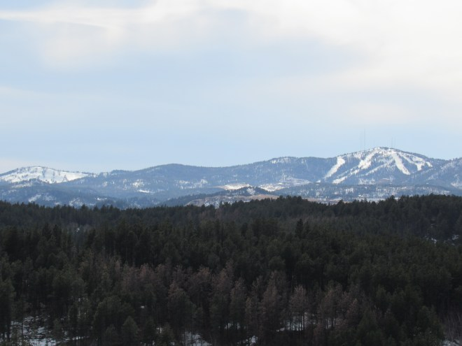 Deer Mountain (6,652 ft.) (L) and Terry Peak (7,064 ft.) (R) are both downhill ski resorts. Photo looks SW.