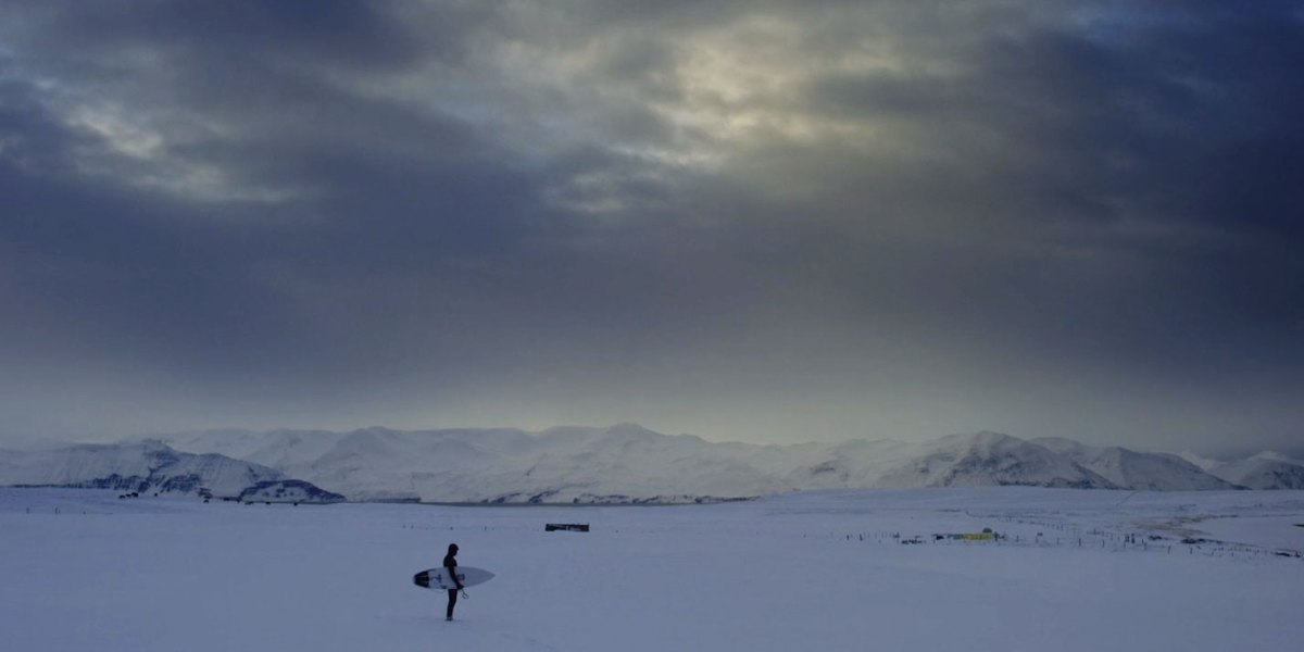 How Do People Survive (Let Alone Surf) During the Arctic Winter?
