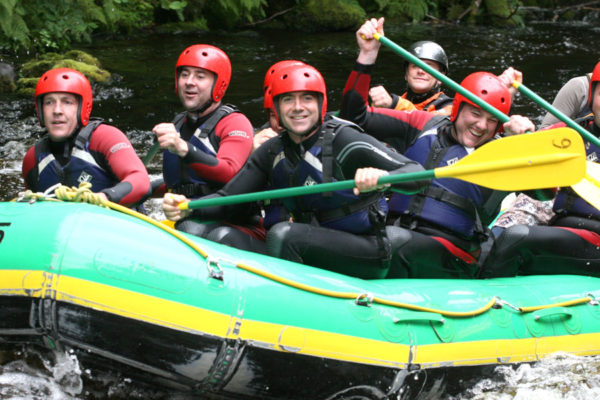 White Water rafting stag group on River Rhondda, Wales