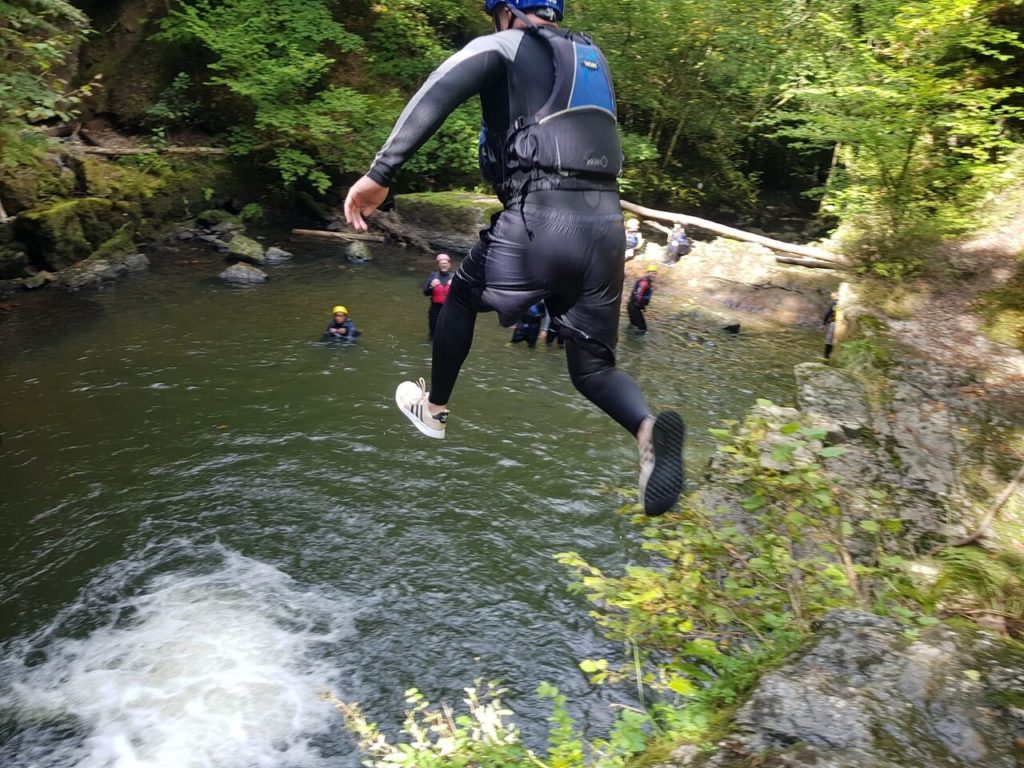 Cliff jump on a Canyoning outdoor pursuits day