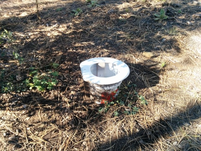5 gallon bucket with a toilet seat on it