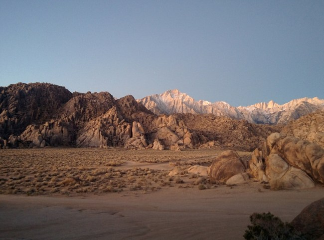 View of the Alabama Hills area with the snow covered peaks of the Mount Whitney Range behind