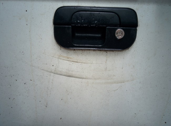 scratches on tailgate from swinging bag of garbage including lots of rusty nails