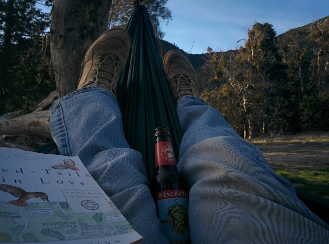 on the hammock with a book and a beer