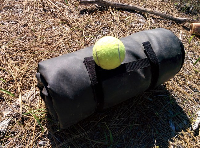 Rolled Up, Waterproof Side Out. Tennis Ball For Scale