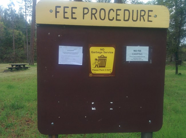 Fee procedure sign with note saying no fees...for now